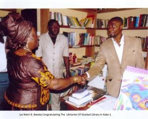 Iya Ndoh B. Bakata Congratulating the Librarian of Stocked Library in Kake 1