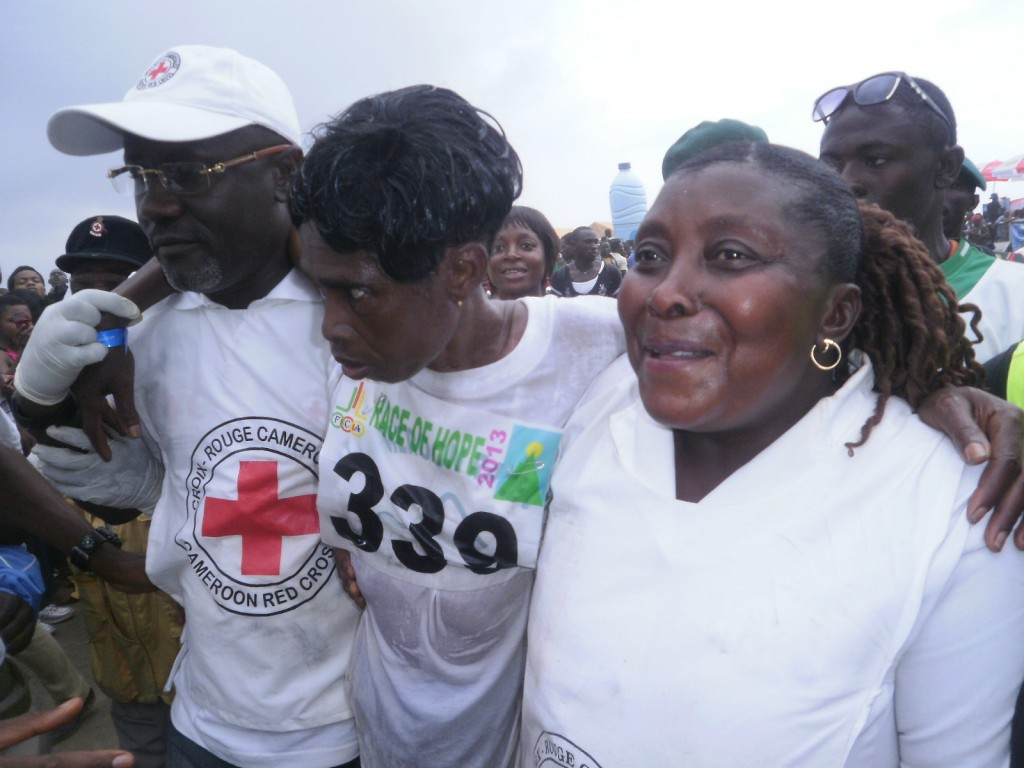 Sarah Liengu Etongue helped by Red Cross Officials after crossing ...