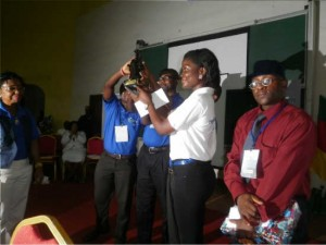 The UB winning team at CSC brandishes their trophy