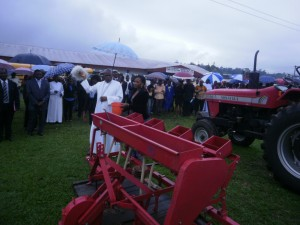 Mgr Bushu blesses the tractors and accessories form MINADER.