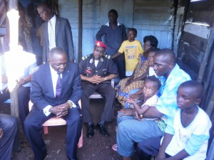 Mr Okalia Bilai(seated in suit) tells a depressing family to take courage after the loss of their loved one