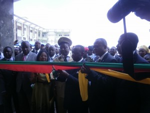 Prof Fame Ndongo cuts the ribbon leading into the new teaching laboratory block of the faculty of health science