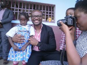 Martha Ifechukwu, pupil of Fonge Academy, pioneer winner of the Gobina Scholarship pose with Dr Gobina