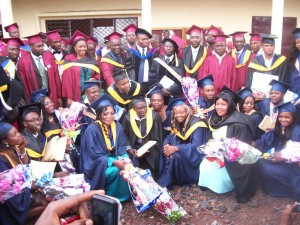HIBMAT staff and graduates in a convivial family picture