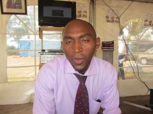 Mungu Charles, a teacher at Alpha Automobile Mechanics Center
