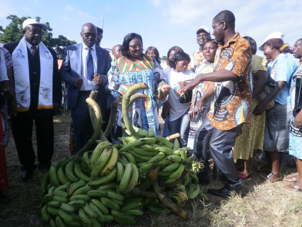 Hon Emilia Monjowa Lifaka(in kaba) receives gifts from her militants in Bonjongo