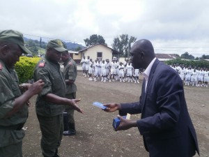 Makomra (R) distributes Bibles to stduents of ENAP