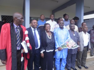 A family pic with some members of jury and staff of UB after the PhD Defence by Dr Henry Muluh (with bouqeut of flowers)