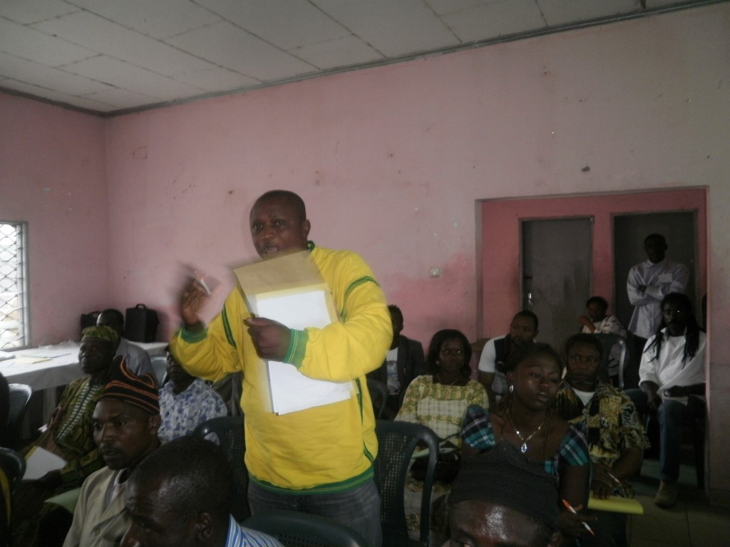 Walter Nkongho, a pig farmer from Limbe, makes a contribution at the seminar