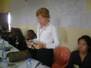 A Cameroon woman reads out some suggestions on how to get access into the decision-making processes
