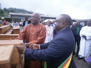 Hon Lisinge(R) symbolically hands a bench to the Fako Divisional Delegate of Basic Education