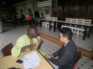 iCameroon.com Walter Wilson Nana(L) talking to Prof. Corey Takahashi in Limbe