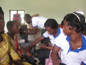 Medical students from The University Teaching Hospital, Yaounde attending to patients