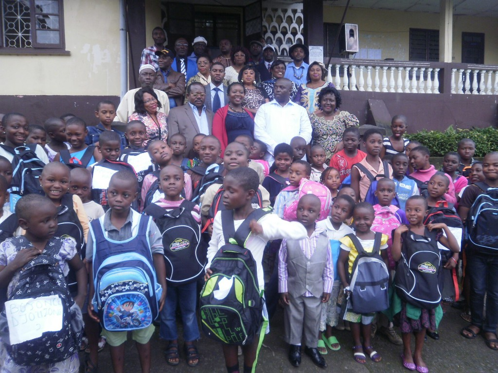 Students from Stranger Quarter, Buea received bags, books, pens, pencils and financial incentives to carry on with the 2014/2015  school year