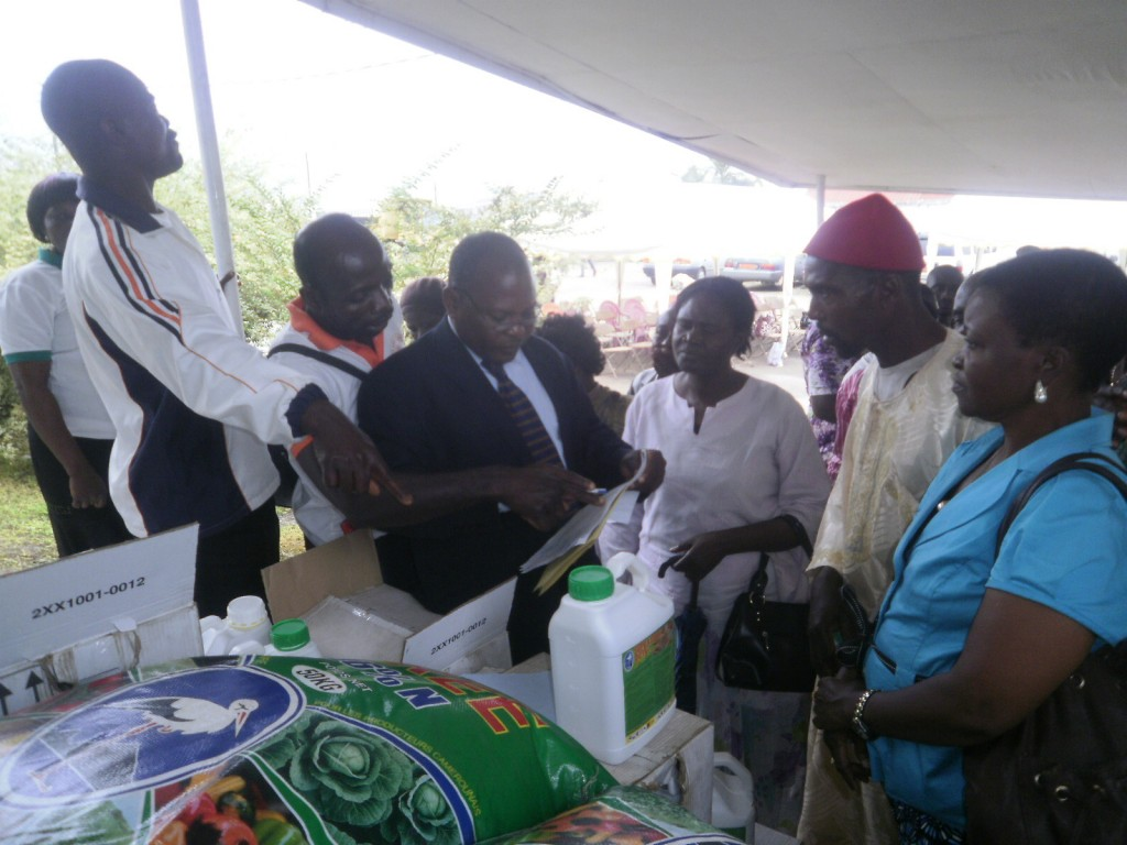 Farmers receive their gifts from a SOWEDA official (in suit) after their names are checked
