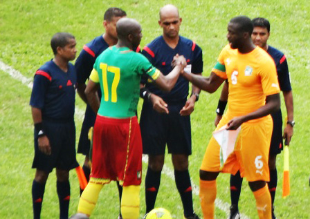 Stephane Etoundi Mbia(L) Cameroon's captain in a friendly duel with Yaya Toure of Ivory Coast before the kick-off in Yaounde